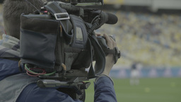 The cameraman shoots the game in the stadium (close-up) Footage