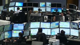 Traders at stock exchange investing in financial market Footage