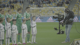 The cameraman with a Steadicam shoots football team before the football match Footage
