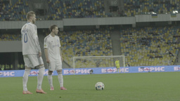 The player kicks the ball during a football match . Slow motion Footage