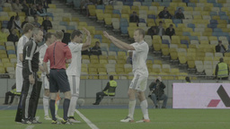 The replacement of a player during a football match . Slow motion Footage