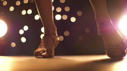 Amazing footage of dancing shoes on tall female legs close-up walking towards Footage