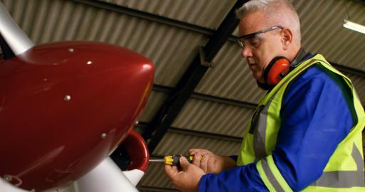 Engineer repairing aircraft at aerospace hangar 4k Live Action