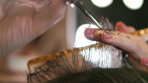 Close up of men's hair cutting scissors in a beauty salon. Frame. Close up of a Footage