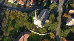 Aerial point of view drone footage of a protestant church in Transylvania, GIF