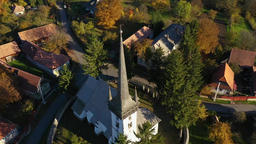 Aerial drone footage of a protestant church in Transylvania, Romania Archivo