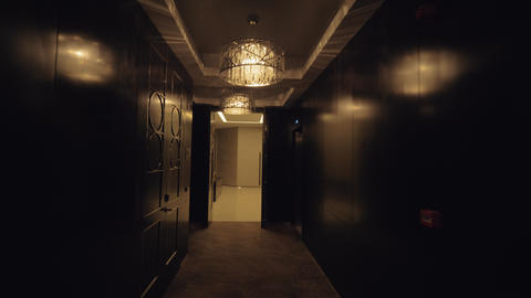 A steadicam shot of a beautiful hotel hallway with presidential suits Live Action