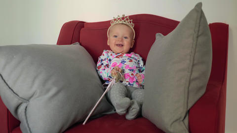 Baby girl wearing a princess crown Live Action