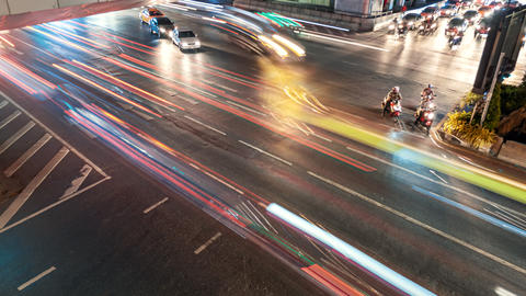 Timelapse Illuminated street traffic on the crossroad in downtown at night time Footage