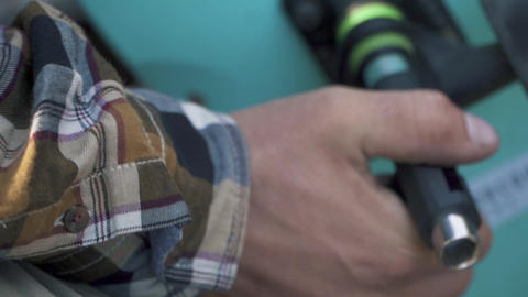 Male hand fixing a skateboard closeup. Cross-key for wheels Footage