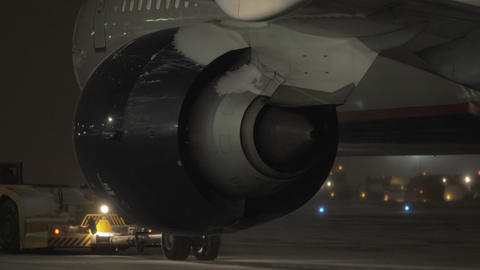A closeup of an airplane engine from the back Footage