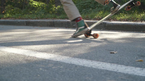 Feet of a guy doing trick on a skateboard. Legs of guy skating on a skateboard Live Action