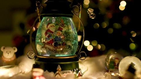 Christmas scene, Santa with child on a sleigh in snow dome ビデオ