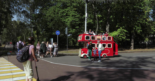 In the city park of Sokolniki a pleasure bus rides and parents walk with Footage