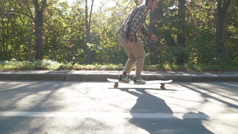 Attractive young man riding skate board. Hipster guy in a... Stock Video Footage
