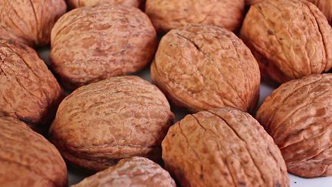 Walnut texture. Brown big whole walnuts as background. walnut nuts pattern close ライブ動画