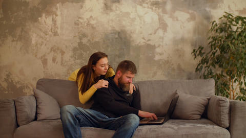 Man busy working laptop while girl feeling lonely Footage