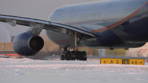 Passenger aircraft on a snowy runway Live Action