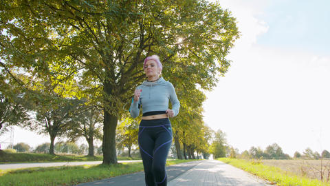 Young Lady with Pink Hair Jogging in the Suburbs. Glitch GIF