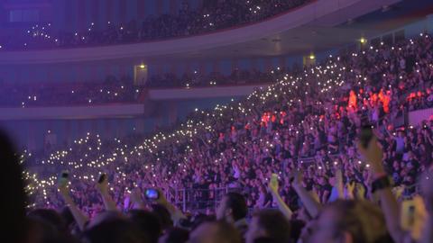 Large audience inside an arena hip-hop concert Live Action