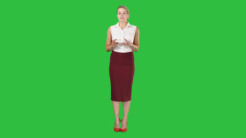 Charming female business lady talking to the camera on a Green Screen, Chroma Footage
