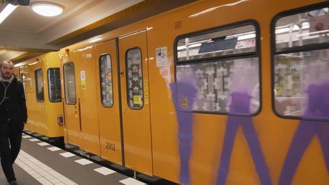 BERLIN, GERMANY - CIRCA NOV, 2018: Subway arriving the Station in Berlin. People Footage