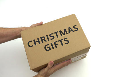 CHRISTMAS GIFTS text on the box in hands GIF