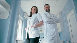 Portrait of Two Confident Doctors in the Hospital Looking to the Camera Footage