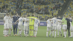 The players of the football team celebrate victory after the match Footage