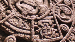 Pan Over Aztec Sun Stone Carving Footage