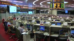INSIDE HONG KONG STOCK EXCHANGE HKE OPENING BELL TRADERS WATCHING STOCKS AND SHA Footage
