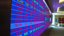 BROKERS LOOKING AT STOCKS SCREEN INSIDE QATAR STOCK EXCHANGE Footage
