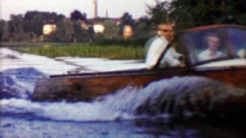 1961: Cool wooden pleasure boat cruising Danish waterways Footage