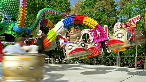 Children And Parents Having Fun In Youths Public Amusement Park Ride stock footage