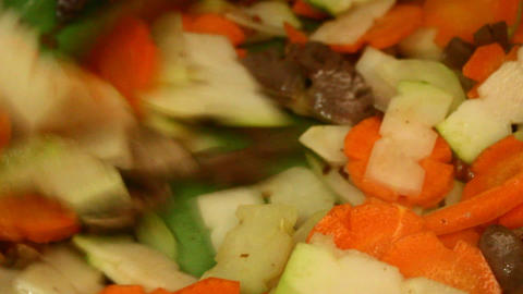 sauteed vegetables and fruit on the kitchen Footage