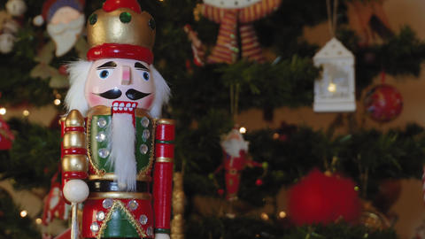Large tin nutcracker soldier on a Christmas tree with blurred background Footage