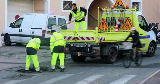 Workmen Repairing Road Surface Damaged By Weather And Traffic Use Live Action
