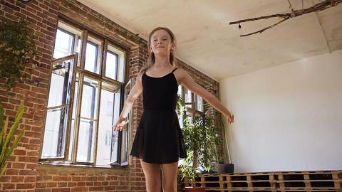 Ballet dancer in black tutu makes flexible in jump. Charming slim girl in black Footage