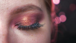 Focused amazing blue eye in rowing pink eyeshadows looking at camera chill, pure Footage
