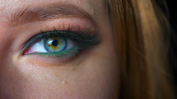 Gogreous green eye of caucainan woman closeup looking at camera in green Footage
