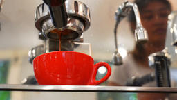 Close-up of espresso pouring from coffee machine. Professional coffee brewing Archivo