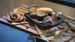 Breakfast with croissants, leaves, cutting board and black coffee composition Archivo