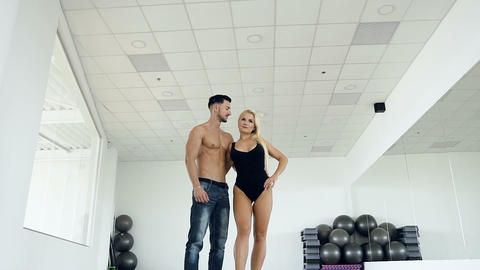 Handsome sport couple on the studio background Live Action