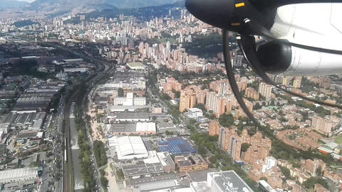 Colombian city of Medellin. Buildings, metro, mountains and river Live Action