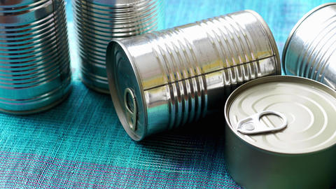Tin cans with food. Conserved food. Closeup of a group of aluminium cans Footage