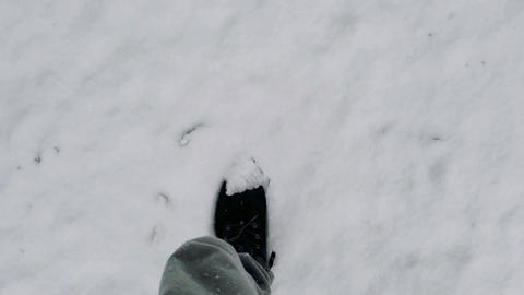 Black boots walking in the fresh snow Stock Video Footage