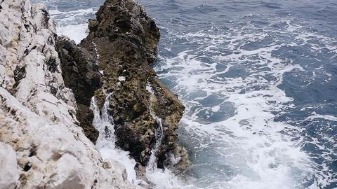 Waves splashing over stones. Sea waves hitting the rocky coast of Adriatic sea Live Action