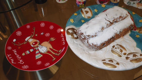 Female cuts Stollen Christmas traditional German marzipan cake on a dish Archivo