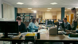 Employees are Working in the Open Space Office at Common Desk with Computers Archivo