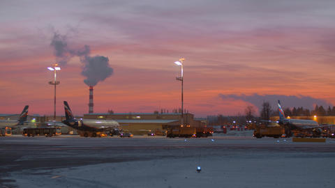 Area of Sheremetyevo Airport with planes and vehicles at the dawn in winter Footage